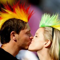 FRANKFURT AM MAIN, GERMANY - JULY 06:  Fans kisses during the FIFA Women's World Cup 2011 Group D match between Equatorial Guinea and Brazil at FIFA World Cup stadium Frankfurt on July 6, 2011 in Frankfurt am Main, Germany.  (Photo by Friedemann Vogel/Getty Images)